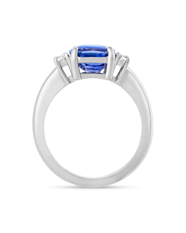 An exceptional cushion-cut sapphire totaling 3.56 carats is set in this classic ring. Unlike the vast majority of sapphires on the market, this example is certified by the Gemological Institute of America (GIA) as untreated, meaning the natural