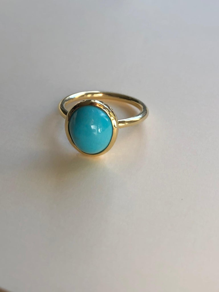 It is exquisitely rare to find 100% untreated turquoise of this color and quality. From the Morenci mine in Arizona, and cut by hand from a master lapidary in Hawaii, this turquoise is unparalleled. The bezel setting is hand fabricated in 18 karat