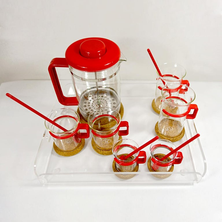 This refined yet striking coffee set was made for two. It is complete and still new as it has never been used. It consists of a French press, two coffee glasses, two espresso glasses, two latte glasses, four tea spoons, seven coasters and a