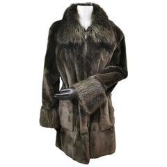 Unused green sheared raccoon coat with natural raccoon fur trim size 12