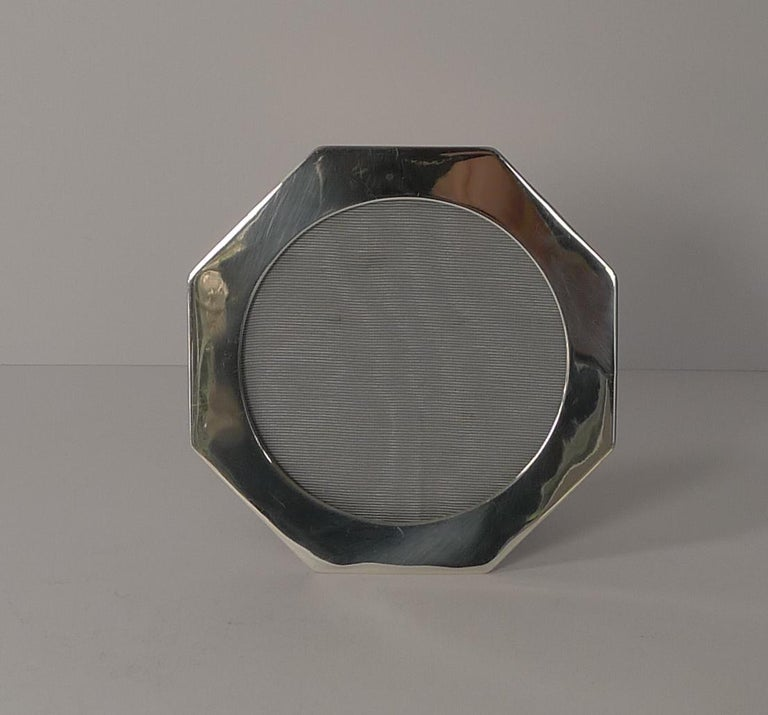 A lovely quality antique English photograph frame made from solid English silver in an unusual hexagonal shape. The silver is fully hallmarked for Birmingham 1911 together with the makers mark for the well renowned silversmith's, Deakin and