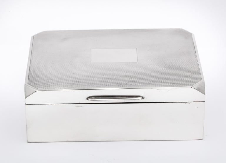 Unusual, Art Deco style, sterling silver table box with engine turned, hinged lid, Birmingham, England, 1963, W.T. Toghill and Co. - makers. Wood lined, black bakelite underside. Corners of lid are designed to make lid look as if it is octagonal in