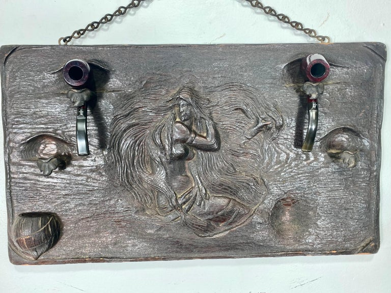 Unusual Art Nouveau woman, relief carved wood and metal pipe holder wall plaque. Stunning nude, wonderful detailing.., bronze mounted, hand forged pipe holders, carved wood match holder, retains original chain (hanging).