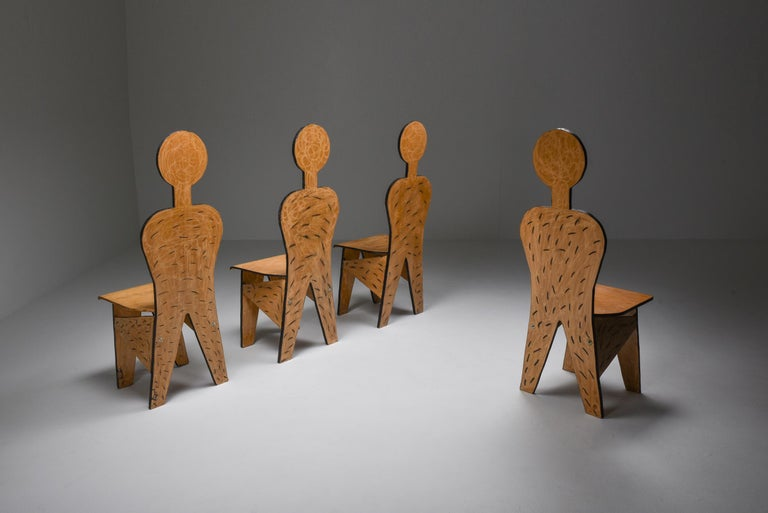 Italian post-modern era dining chairs, functional art, collectible design  Fun set of chairs reminiscing humanoid figures These are in fact functional sculptures which bring humor into your domestic environment. Quite an important trait nowadays.