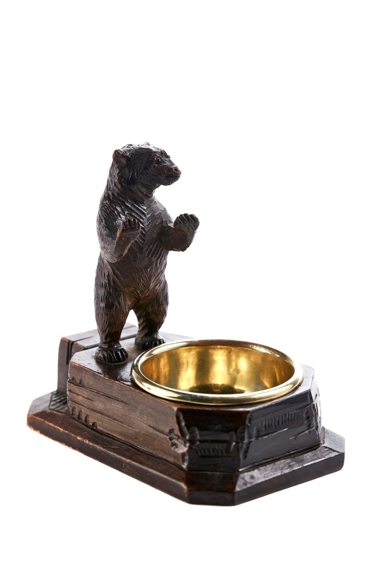 This is an unusual carved 19th century black forest bear match box striker, lovely quality carved bear standing on a wooden base with a brass ashtray to the front.