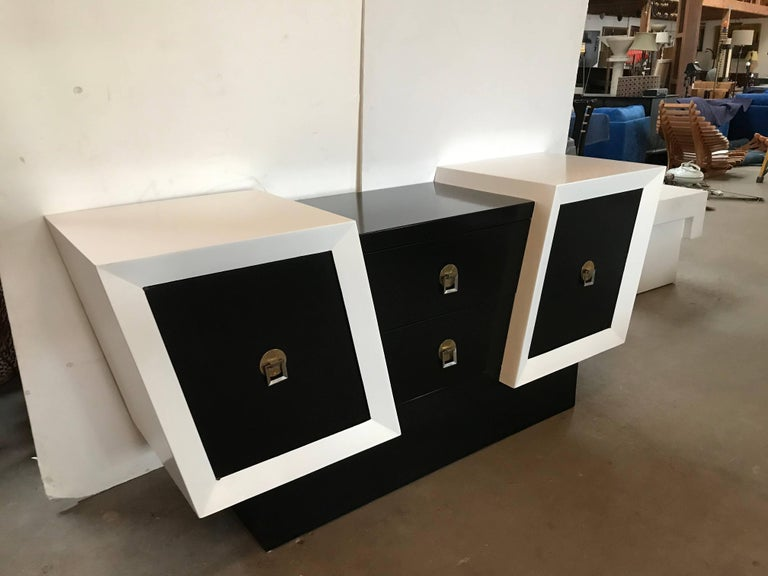 Unusual oak credenza in black and white lacquer with brass-plated hardware. Unique diagonal design has two pull out drawers as well as doors on either side that open to reveal shelves. Newly refinished. 