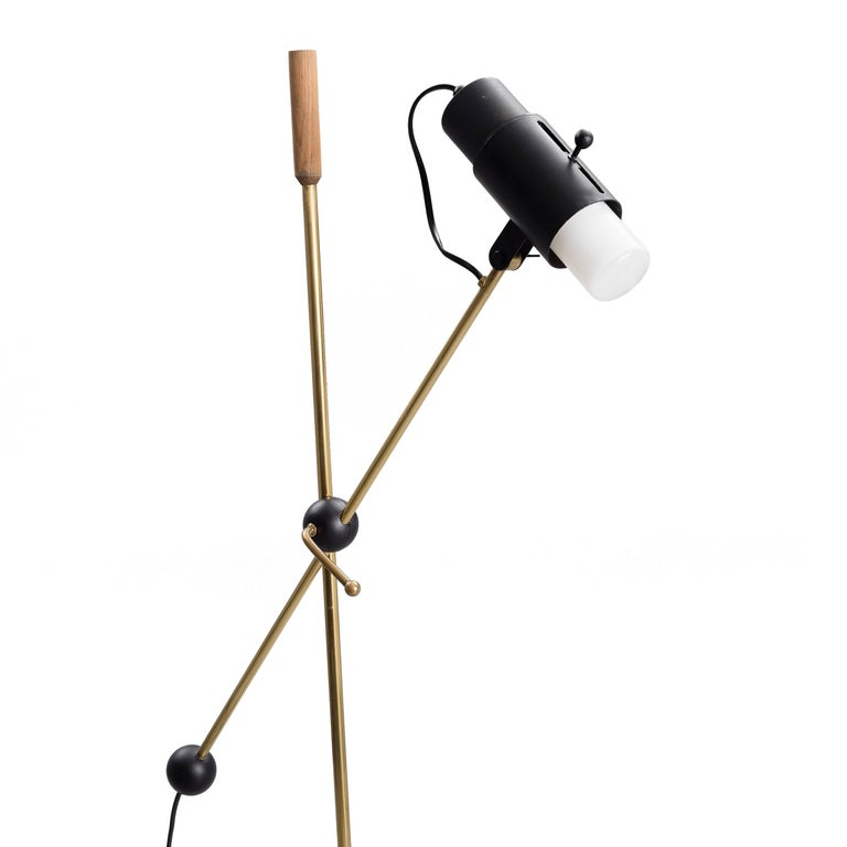 Such an unusual example of Tapio Wirkkala's coveted lighting.  This model has an adjustable light source which is controlled by a sliding bar on the lamp head.   Highly adjustable base andcentre column which can raise and lower, swivel and