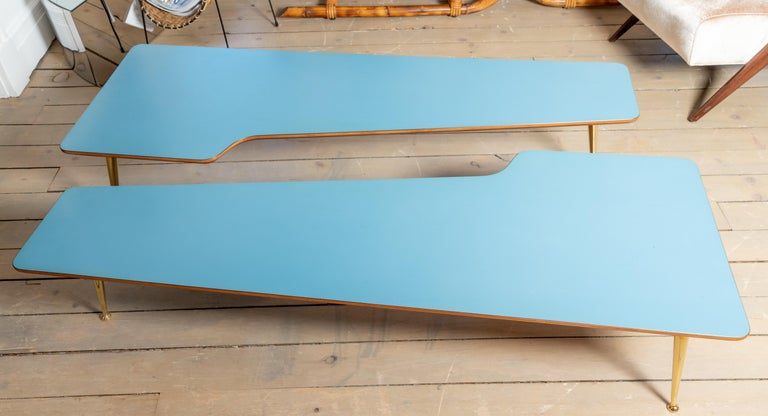 Unusual form three brass leg with blue laminate top coffee table, in the style of Gio Ponti, circa 1960