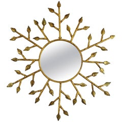 Unusual French 1950s Hand-Hammered Gilt Iron Leafed Wall Sunburst Mirror