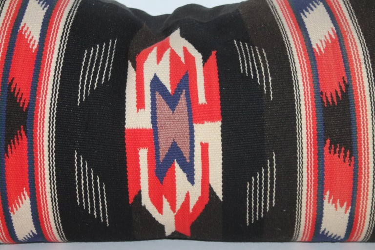 Unusual Mexican Serape pillow with white fringe and black linen backing.