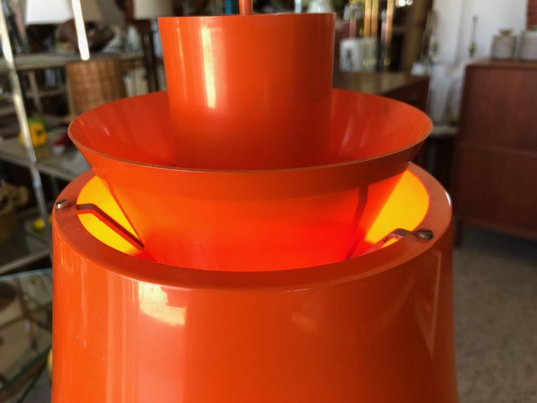 An unusual mid century Danish pendant lamp. All original with orange cord. Designed by Jørn Utzon, produced by Nordisk Solar Compagni, ca' 1963. A quick note about the architect: