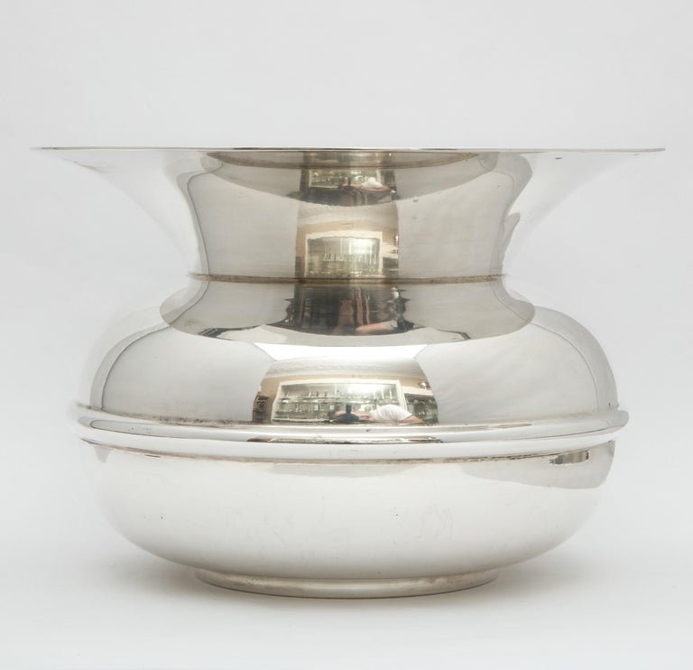 Unusual, Mid-Century Modern, sterling silver spittoon, Tiffany and Company, New York, circa 1950s. Measures 51/2 inches high x 8 inches diameter (at widest point). Weighs 27.665 troy ounces. Can be used as a vase. Dark spots in photos are