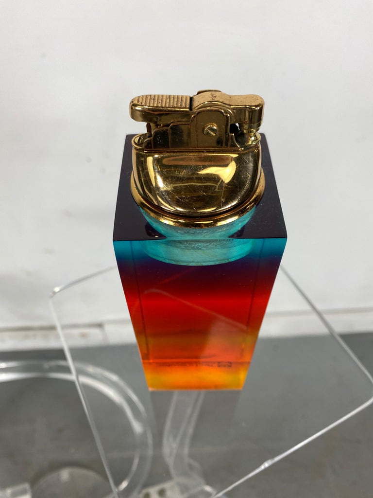 Unusual modernist multi-color acrylic / Lucite cigarette lighter, advertising Technicolor Corporation. Appears to be new/old stock, never used. Possible award or employee give away.