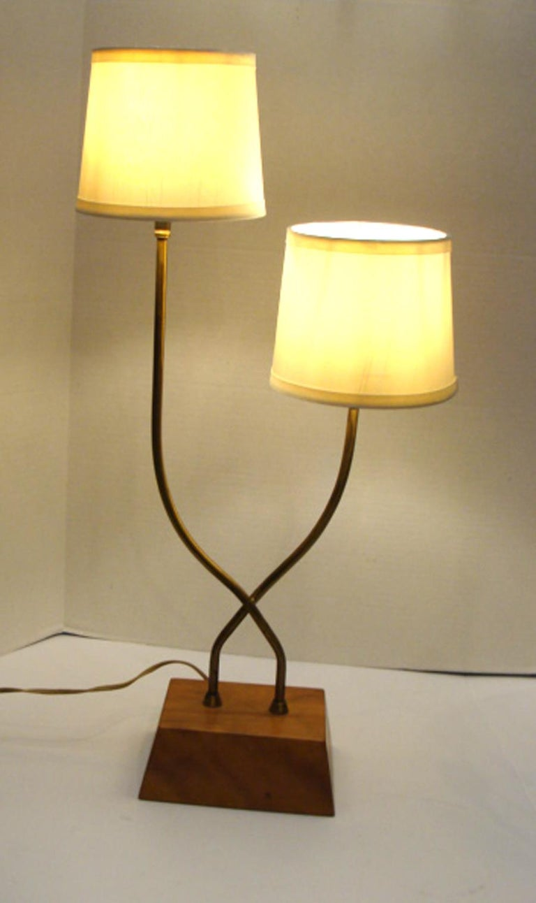 Truly rare and unusual pair of Heifetz lamps. Tubular brass rods, transverse mounted on solid birch wood bases. Heifetz mark on rear of each wood base. All original working condition. No repairs or damage. Shades are not included but are shown for