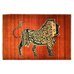 Unusual Persian Lion Carpet in Red, Black, and Gold Wool