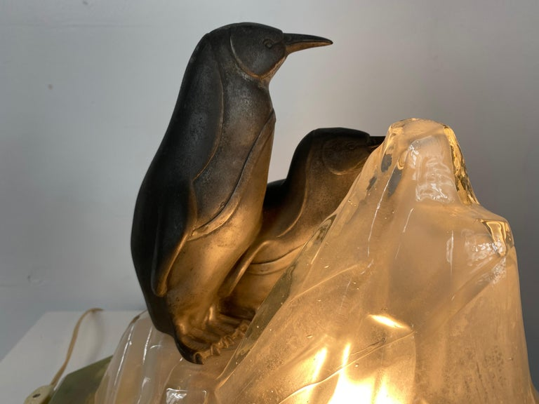 Unusual, stylized Art Deco penguin's and glass ice glacier table lamp, truly charming and very unusual, featuring two stylized penguins a-top a cubist shape ice glacier. Mounted to green marble base. Tested and all electrical working perfectly.