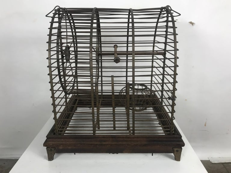 Unusual turn of the century industrial brass small animal cage with wheel. Possibly made by Pierce Arrow. Buffalo NY. Superior quality and construction. Smooth spinning hamster wheel, charming little decorative item.