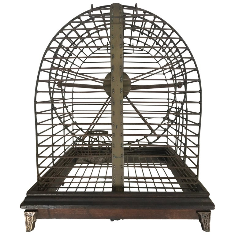 Unusual Turn of the Century Industrial Brass Small Animal Cage with Wheel For Sale