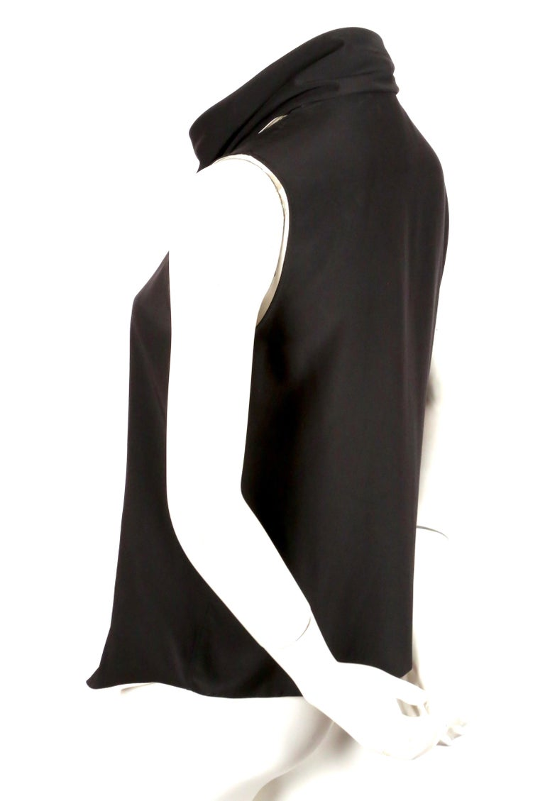 Black and cream silk top with draped wrap scarf neckline designed by Phoebe Philo for her first collection for Celine - Resort 2010. French size 36. Measures approximately: 14