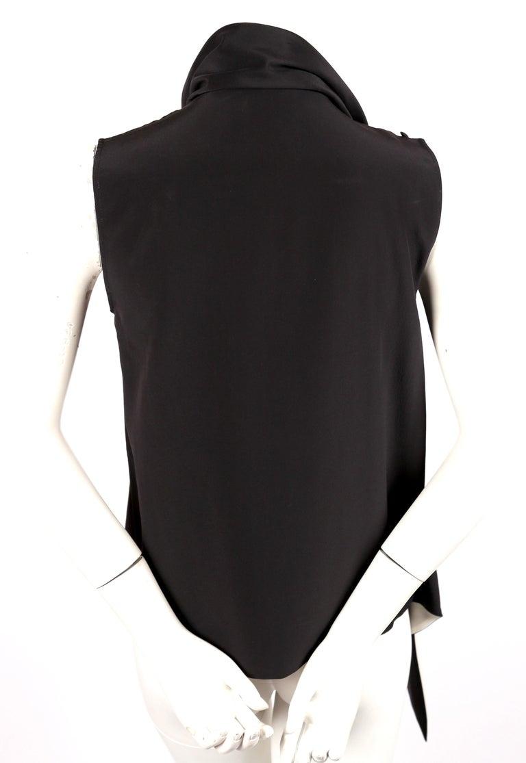 Women's or Men's unworn 2010 CELINE by Phoebe Philo black & cream silk top with draped neckline For Sale