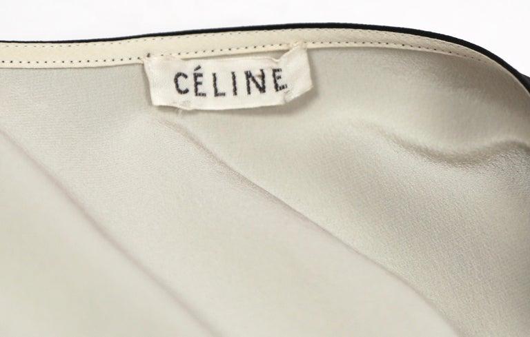 unworn 2010 CELINE by Phoebe Philo black & cream silk top with draped neckline For Sale 1
