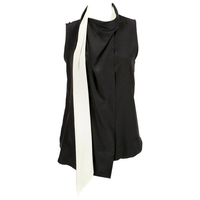 unworn 2010 CELINE by Phoebe Philo black & cream silk top with draped neckline For Sale