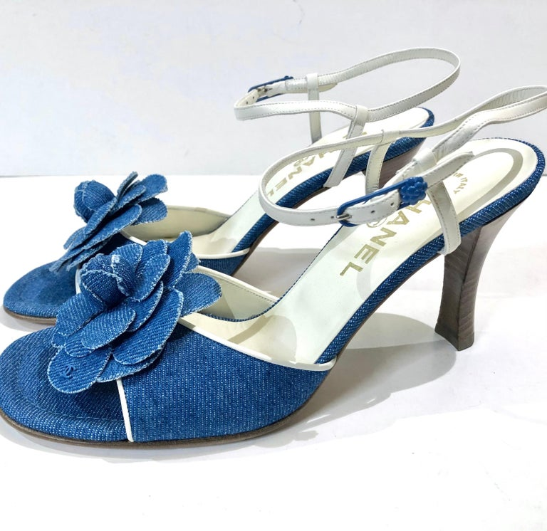 - Chanel denim camellia strap sandals heels. It has never been worn before.   - Flower hardware closure.   - Size: 38.5