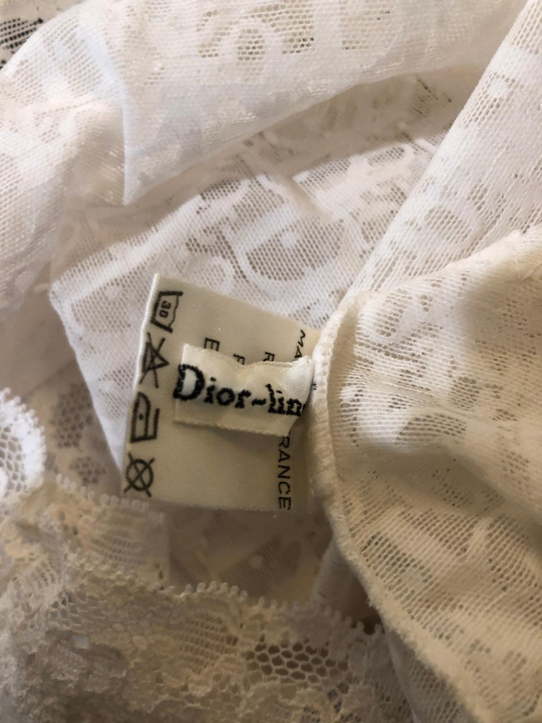 Sexy never worn 90s vintage CHRISTIAN DIOR white sheer logo lace monogrammed lowrise hot pants! Flattering boy short style! Features the DIOR logo throughout, with CD monogrammed at the waistband. In great unworn condition. Made in