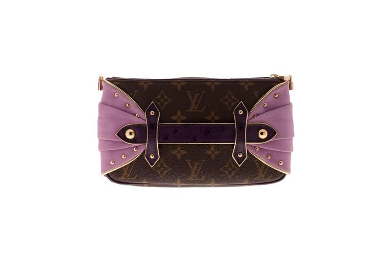 Extremely Rare Louis Vuitton Pochette Produced Only For Selected Clients On Invitation Only  Gorgeous Monogram Canvas & Ostrich Skin Pochette  Jeweled LV Mini Lock Strap   Details:  A Louis Vuitton signature piece that will last you for many years,