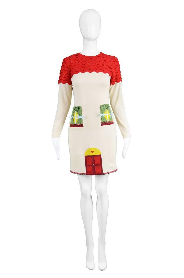 "Unworn Moschino Vintage 1980s Surrealist House Cream & Red Wool Blend Knit Dress  Estimated Size: UK 10/ US 6/ EU 38. Please check measurements.   Bust - 34"" / 86cm Waist - 28"" / 71cm Hips - 36"" / 91cm Length (Shoulder to Hem) - 34"" / 86cm Shoulder"