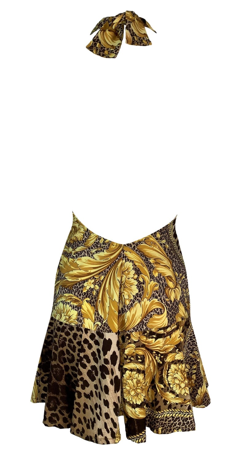 DESIGNER: S/S 2001 Versace  Please contact for more information and/or photos.  CONDITION: Unworn  FABRIC: Nylon & Spandex  COUNTRY MADE: Italy  SIZE: 40/S  MEASUREMENTS; provided as a courtesy only- not a guarantee of fit:  Chest: open, Waist: