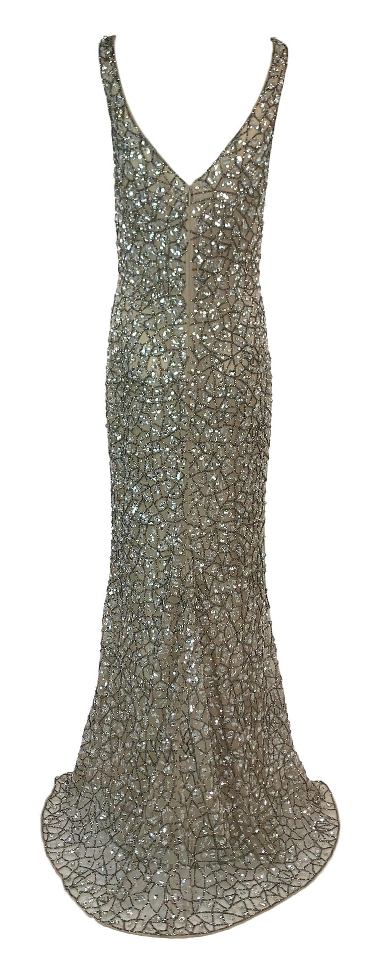 DESIGNER: S/S 2019 Roberto Cavalli  Please contact for more information and/or photos.  CONDITION: Unworn- comes with tags. May have minor bead loss- we looked over the entire dress and did not find any but this dress is completely covered so we may