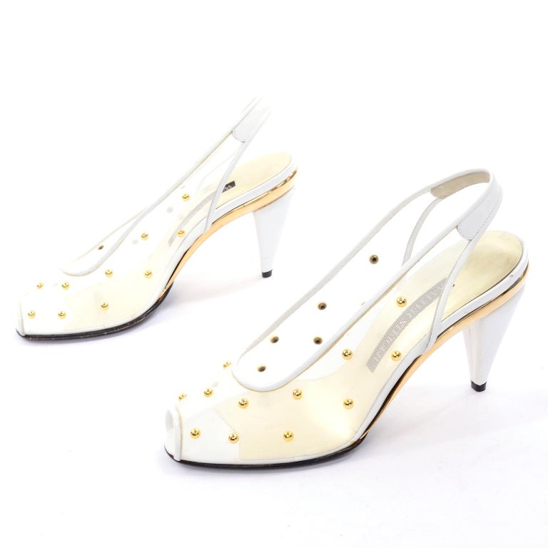 These are stunning vintage Walter Steiger white mesh slingback heels covered in gold tone dome studs. These vintage shoes have a leather sole and peep-toe. We love the gold part of the soles! These would make great wedding shoes! They appear never