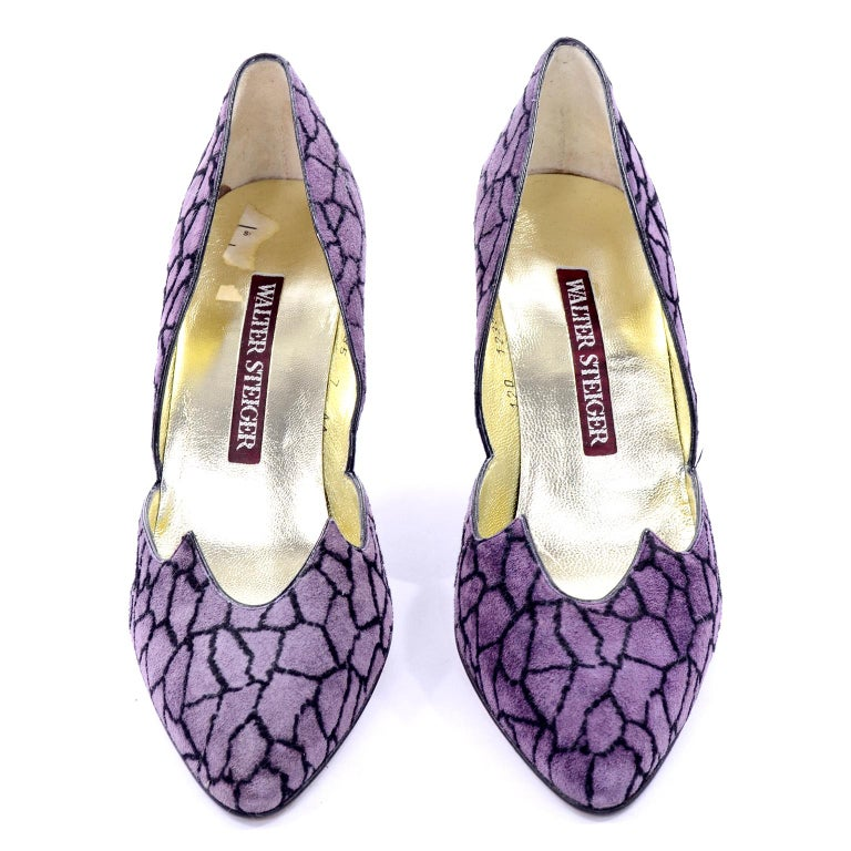 We are obsessed with vintage Walter Steiger footwear!  These purple suede heels have dramatic uppers with sharp cutwork and a giraffe or abstract pebbled black design. Size 7AA. Made in Italy. Never worn!  HEEL: 3.5