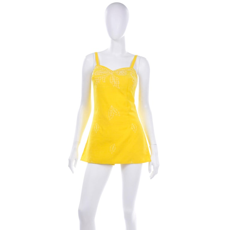 this is a pristine Tina Leser for GaBar New York vintage, never worn early 1960s swimsuit or romper. We love the  fabulous shade of sunshine yellow and the checked gingham applique at bustline and pretty white leaf embroidery. This is a super