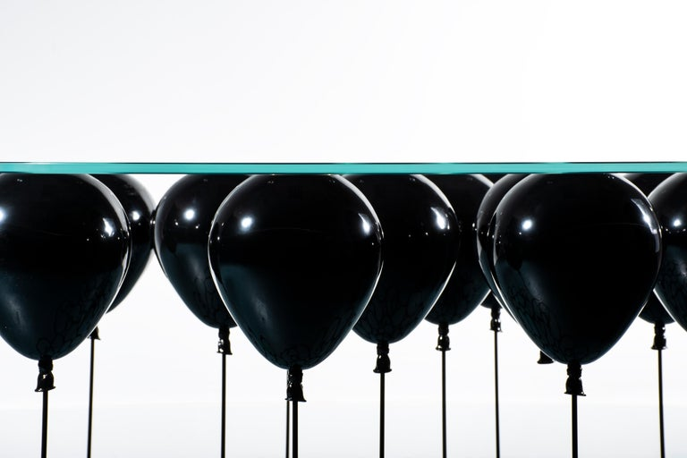 For those who prefer their fun a little darker, The Up! Balloon Coffee Table from acclaimed British designer Christopher Duffy has gone macabre with a glossy black finish, available on both the balloons and the legs.  Adapted from the original UP