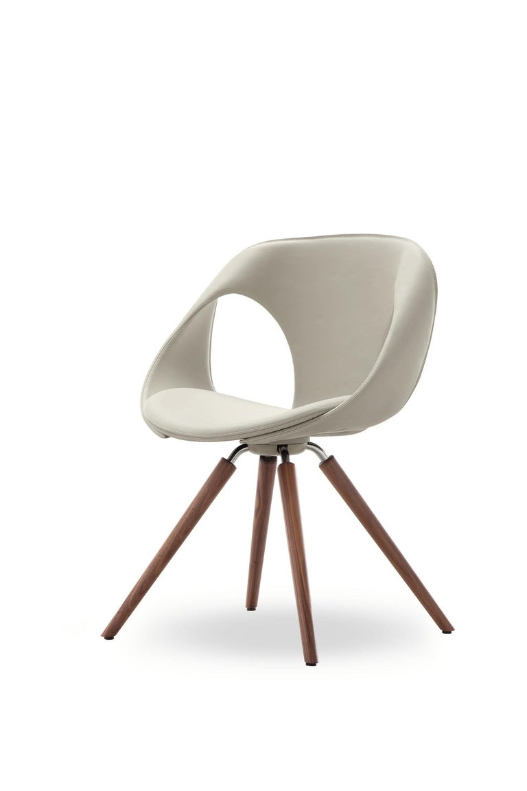 The Up chair with unique flowing wood arms by Tonon is an highly chair. For this version of the popular Up chair you can choose between wood legs and arms in either oak or walnut.  The seat of the chair is upholstered in soft Italian leather in