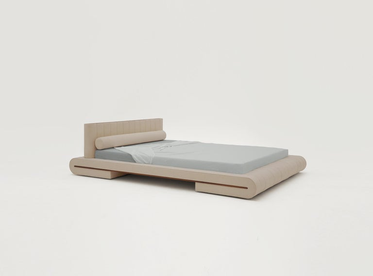 Docked en Rio has a fully upholstered bed frame. The cotton weave is stretched around a folded mattress frame inspired by traditional Japanese furniture. The form is composed of modular cross-sections with a walnut rail that accentuates the folding