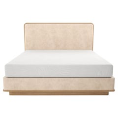 Upholstered Bed with Rounded Covered Headboard on Carved Wood Platform and Base