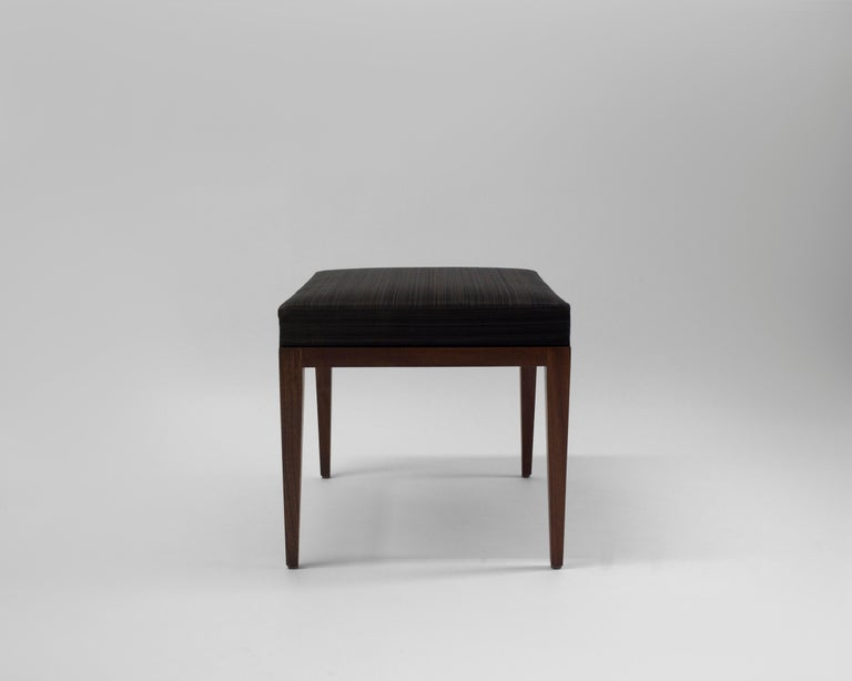 The Denton bench made by LF Upholstery is shown with brown and taupe patterned horsehair with soft foam padding. It has a hand carved mahogany wood and finished frame with tapered legs - it is shown without trim but can be made custom with choice of