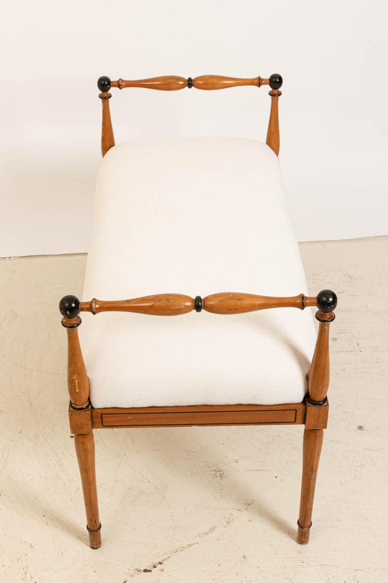 Upholstered Biedermeier style bench with turned armrests,circa 1940s. The piece has also been freshly upholstered. Please note of wear consistent with age including finish loss and scratches. Made in Italy.