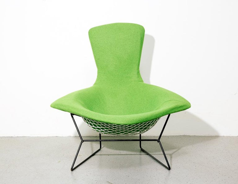 Bird chair designed by Harry Bertoia for Knoll, 1950s. White wire frame on black rod base. Newly upholstered in lime green Maharam wool.