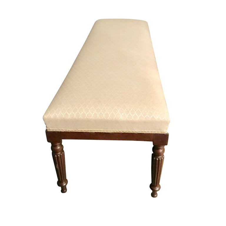 19th century Italian bench recently upholstered Traditional turned walnut legs Two available Ideal for the end of a bed.