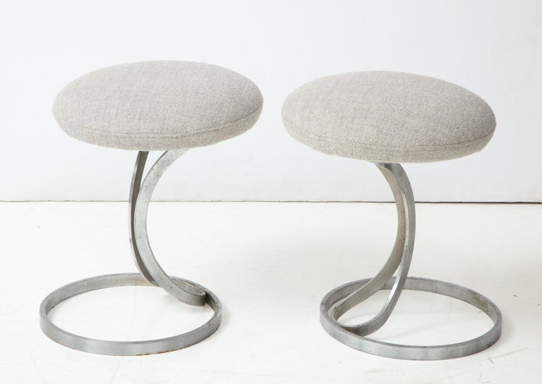 Upholstered metal stools by Boris Tabacoff, France, 1970s Two available, sold individually. Upholstered in a textured light grey boucle fabric.