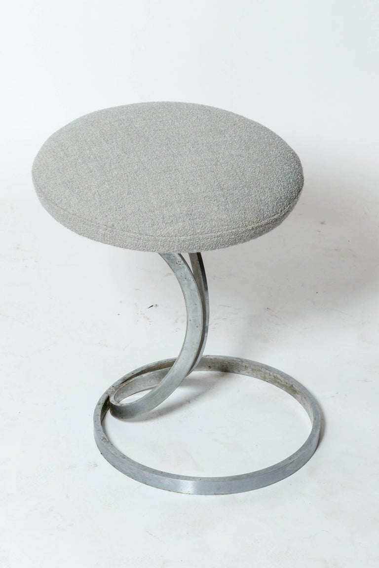 Upholstered metal stools by Boris Tabacoff, France, 1970s Three available, sold individually.  Upholstered in a textured light grey boucle fabric.
