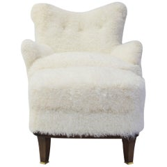 Upholstered Ottoman Shown with Willow Club Chair Covered in Shearling