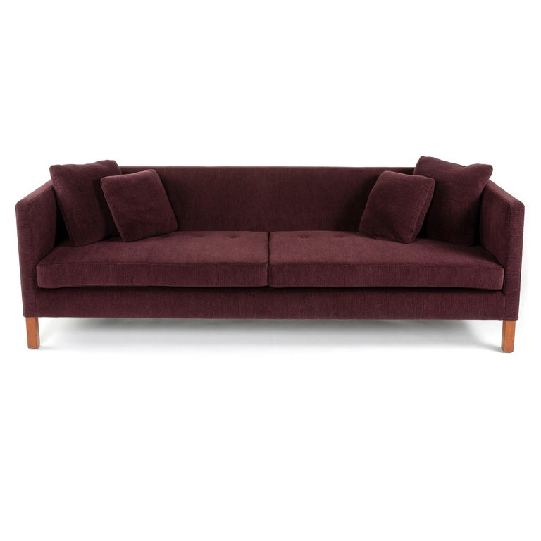 A Dunbar square arm sofa designed by Edward Wormley with two slab seat cushions and four pillows. Newly reupholstered in a burgundy wool chenille.