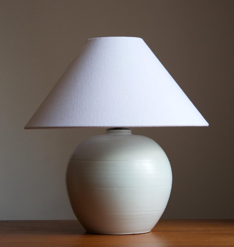 An early modernist table lamp. by Upsala-Ekeby, Sweden, 1930s. Stamped. Incised decor.   Stated dimensions exclude lampshade. Height includes the socket. Sold without lampshade.  Other designers of the period include Ettore Sottsass, Carl Harry
