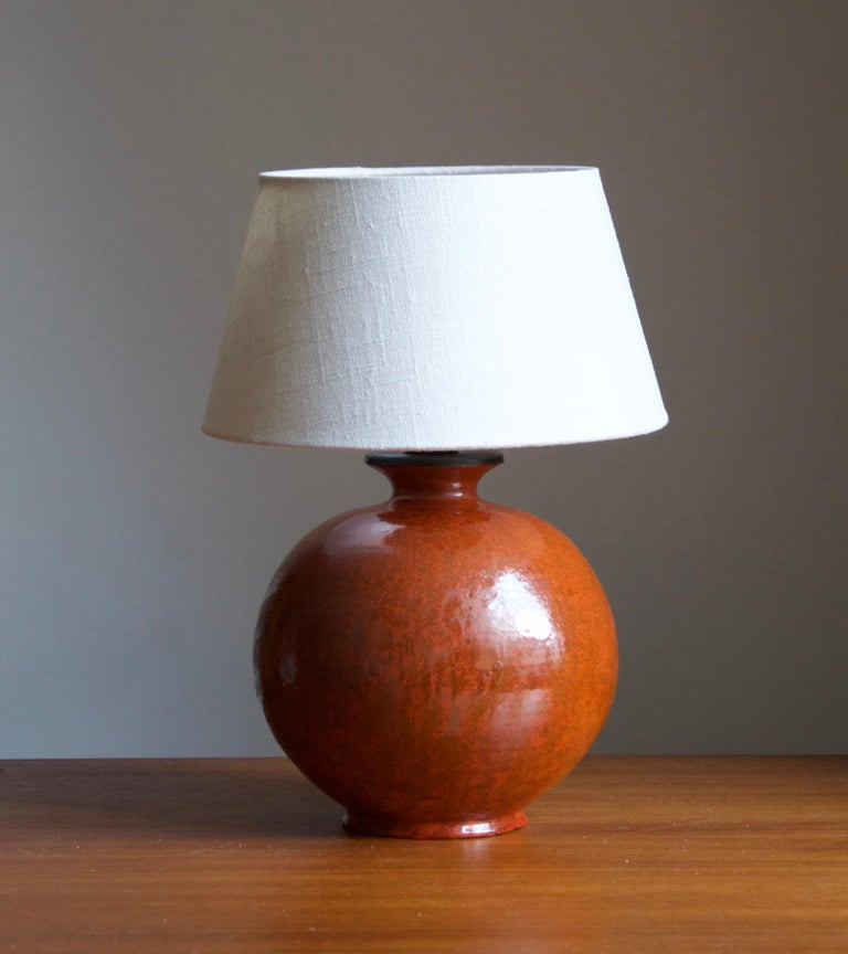 An early modernist table lamp. by Upsala-Ekeby, Sweden, 1930s. Stamped.   Stated dimensions exclude lampshade. Height includes the socket. Sold without lampshade.  Other designers of the period include Ettore Sottsass, Carl Harry Stålhane, Lisa