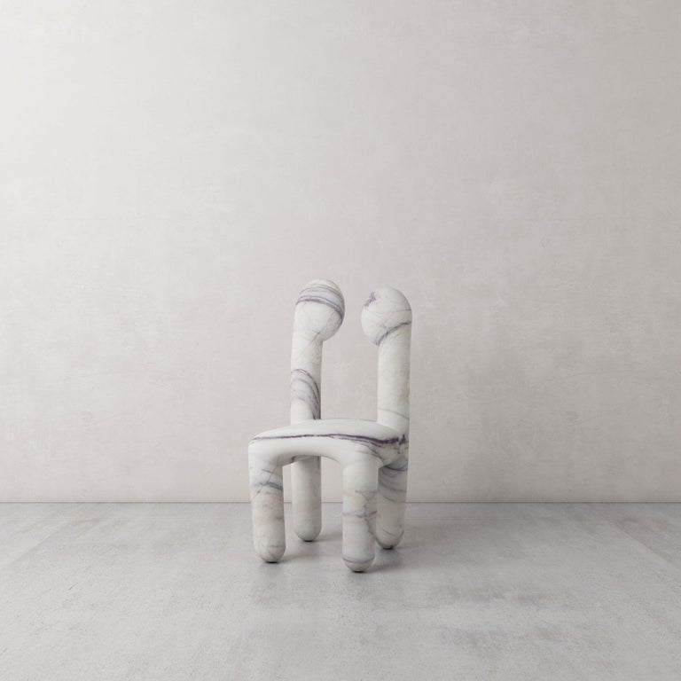 Urania Chair by Pietro Franceschini Sold exclusively by Galerie Philia Limited edition of 8, signed and numbered Dimensions: H 80 x W 36 x D 36 cm Seat Heigh: 38 CM Weight: 65kg Materials: Marble (Calacatta Viola)   Pietro Franceschini is